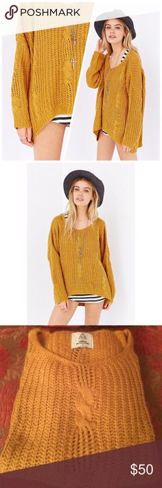 UNIF X UO mustard cable knit sweater Mustard yellow cable knit sweater. Oversized fit and soft texture. Great for layering! UNIF Sweaters