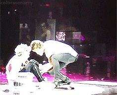 harry pushing niall and his laundry basket over with the big tube thing...i think (gif)