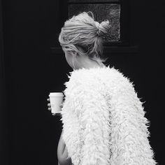 Cozied up. / White fur street style.