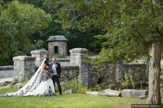 Wedding photography in front of stone castle, black and white wedding dress