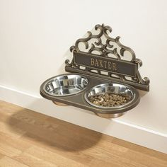 Raised bowl mount for pet food. No more moving the bowls to sweep!!