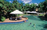 Garden pool with waterslide at Cairns Coconut cabin and caravan accommodation park