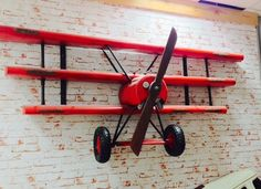 The red baron custom airplane wall shelves for boys who like toys Airplane Room, Airplane Decor, Airplane Lights, Wall Bookshelves, Wall Shelves, Aviation Decor, Woodworking Projects, Diy Projects, Red Wall Art