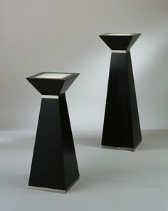 """MODERN WOODEN PEDESTAL. Uniquely designed square top illuminated contemporary pedestal with dark brown wood and brushed nickel finishes. Our modern wooden pedestal comes in several heights, and uses one (1) energy saving 15w Incandescent B torpedo bulb with a candelabra base (included) and has a step on/off switch. The perfect addition to your contemporary home, office or apartment.    Short Modern Wooden Pedestal: 31"""" H x 12"""" W x 12"""" D  Tall Modern Wooden Pedestal: 37""""H x 12""""W x 12""""D"""