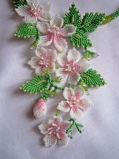 Cascading Flowers by June Huber. Materials used: Japanese seed beads; Seed Bead Flowers, French Beaded Flowers, Cascading Flowers, Seed Bead Jewelry, Bead Jewellery, Beading Projects, Beading Tutorials, Beaded Jewelry Patterns, Beading Patterns