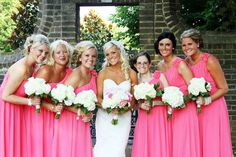 white flowers, solid bright bridesmaids dresses. cute. Except pink flowers for bride