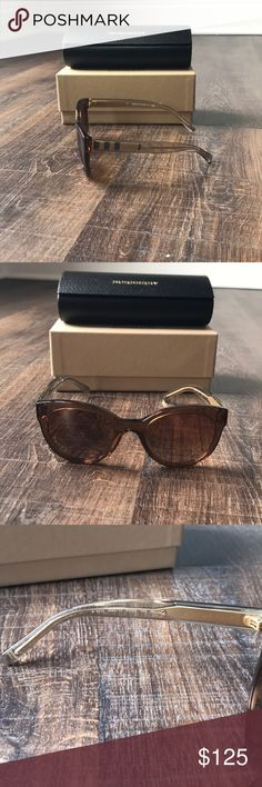 NWT Burberry Sunglasses 100% Authentic Burberry sunglasses.   Classic Burberry plaid on side.    What's included: Burberry Sunglasses Burberry Case & Cloth Burberry Accessories Sunglasses