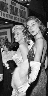 Marilyn Monroe & Lauren Bacall outside the theater at a showing of How to Marry a Millionaire, also starring Betty Grable. Marilyn Monroe & Lauren Bacall outside the theater at a showing of How to Marry a Millionaire, also starring Betty Grable. Hollywood Stars, Hollywood Fashion, Hollywood Icons, Old Hollywood Glamour, Golden Age Of Hollywood, Vintage Hollywood, Classic Hollywood, Old Hollywood Movies, Lauren Bacall