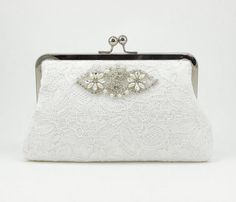 A classic lace kisslock purse with beaded detail. Imagine this with a pearl bracelet and necklace, timeless elegance :) #wedding #purse #handbag