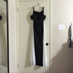 Long black and white formal dress Long formal black and white dress with an open back design. Practically new, only used once! BCBGMaxAzria Dresses Prom