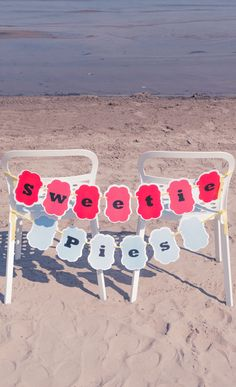 Add a punch of color to your head table with these sweetheart chair banners!