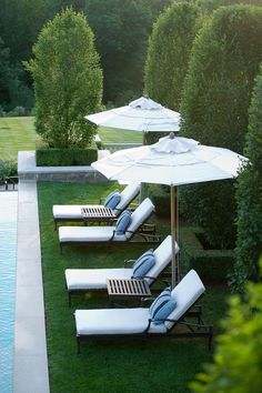 Pool side seating and umbrellas