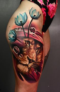 lion and flower #tattoo on hips