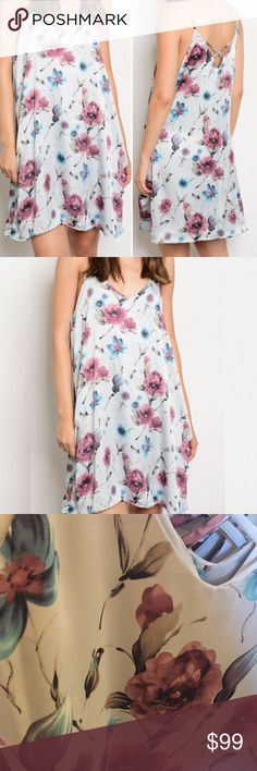 """S-L Silver Blush Floral dress Made in USA - excellent quality -silky feel. Silver/grey with gorgeous floral pattern with shades of mauve/rose and teals. Fully lined so is not sheer (see photo). Measurements pictured are of size small, runs a little big, so you may want to size down if you want more fitted. Small 18"""" bust medium 19"""" bust large 20"""" bust. Has pockets! 100% Polyester feels silky and soft. Cute summer sundress & perfect Date night dress. Dresses"""