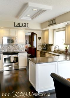 kitchen makeover cream glazed cabinets and grant beige walls and mosaic tile backslash