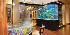Custom Aquarium Wall, to Archway,  to Bar... by the Aqua Design Group