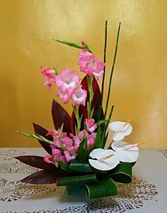 Pink gladiolus and white anthuriums.