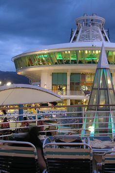 Who says pool decks are just for the day? The lounge chairs on Voyager of the Seas are a great place to watch the sights even after the sun goes down.