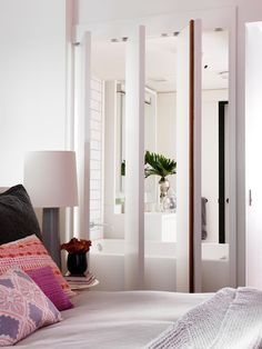 Open up a small bathroom and bedroom with a pivoting wall.