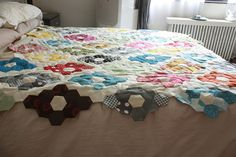 A hexagon quilt coming together.