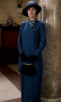Lady Mary is ready to call on friends in this stunning clean-cut navy blue outfit.