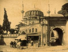 Mosqu̬e Laleli Mosque in Instanbul Turkey, photographed by S̩bah & Joaillier between 1888 and 1910. This albumen print shows a shop in wall next to entrance of Laleli Camii (mosque).