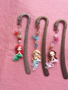 Markers of books with mermaids in fimo, polymer clay