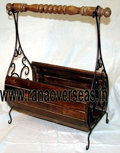 Wooden Magazine Rack Rana Overseas is the leading manufacturer, supplier and exporter of Wooden Magazine racks. We have various designs and Wood iron combinationa Magazine racks available in different sizes and shapes.