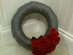 Grey Yarn Wreath with Red Roses.  facebook.com/copelandcrafts