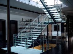 http://www.stairporn.org/2011/03/15/5-story-glass-and-stainless-steel-stair-by-jaroff-design/