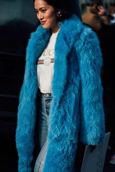 The it girl look of the season - Gucci logo tee, straight-leg jeans and a faux fur jacket