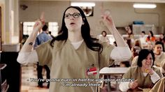 """Orange Is the New Black, season 1, episode 9, """"Fucksgiving,"""" aired 11 July 2013. Alex Vause is played by Laura Prepon. Tiffany """"Pennsatucky"""" Doggett, played by Taryn Manning: """"You know, you're going to Hell! And you're gonna burn there for the entire eternity!"""" Alex, as she gives both middle fingers: """"I'm already there."""""""