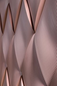 Note Design creates bulging weave-effect tiles for Kaza Concrete