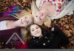 Love this photo of best friends laying in leaves. So cute! #arisingimages #michigan #fall #friends #leaves #photoshoot #senior #pictures
