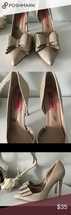 Betseyville Gold Heels Sparkly gold heels with bows on the toes. Sz. 8. These heels have been worn but only a handful of times. See photos for wear. Betsey Johnson Shoes Heels