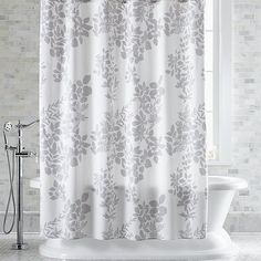 This graphic botanical print by Fujiwo Ishimoto scatters realistic white silhouettes on soft grey. This nature-inspired shower curtain creates a serene setting, especially when paired with matching Kukkula bath towels.
