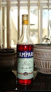A bottle of campari-alcoholic liqueur, Beer Bottle, Vodka Bottle, Campari And Soda, Alcoholic Drinks, Cocktails, Campari Drinks, Beverage Center, Citrus Juice, Italian Wine