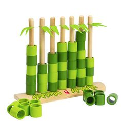 Watch how quickly this bamboo forest grows! Take turns planting it by putting the colored bamboo rings on the shoots to connect four rings of the same color. Look all around! You want to connect your rings, but you need to block your opponent at the same time.   Quattro is a strategy game.  Appropriate for 2 players. Ages 3 and up.  |  Award: Oppenheim Toy Portfolio 2012 - Gold  |  Conceptual Designer: Aniwat Rerkrai, 2006.