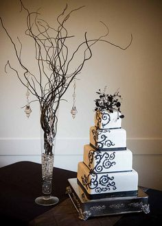 I Love this Black and White Wedding Cake.  It would look beautiful with your bright bouquet flowers on the top- for a topper.  Simple and elegant.