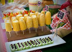 Fall Picnic Party  ....corn on a stick seems so obvious, but I've never served it this way....looks more festive somehow....I like the veggies in a cup of dip behind the corn too...I've seen that here on pinterest  Keri Always