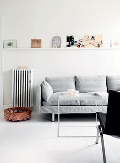 bright living room with simple light grey sofa