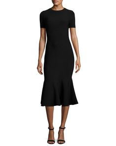 Milly stretch-knit midi dress. Crew neckline. Short sleeves. Mermaid silhouette. Hem hits below the knee. Exposed back zip. Viscose/Elite polyester/spandex. Imported.