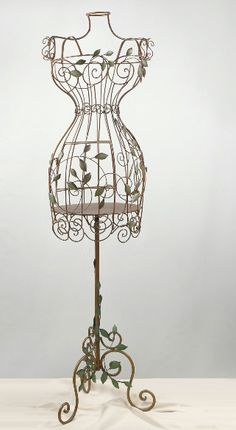 """Metal """"Mannequin"""" Bird Cage painted brown with green leaves stands 60"""" tall x 16"""" wide x 10"""" deep (at the widest point) torso only is 32"""" tall with  24"""" pole that connects mannequin to base. $57.00"""