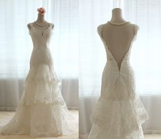 Vintage French Lace Wedding Dress Bridal Gown Deep Open Back Layers Tiered v-neck dress with Train Thin Straps. $486.00, via Etsy.