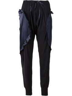 Kendall, Rihanna, and more celebrities wearing gym wear casually show the whole athleisure trend isn't dying any time soon. Get in on the look with these 27 pieces, including these Tsumori Chisato Ruffled Panel Track Pants.