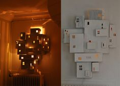 Plain old painted boxes with holes cut in them that are held together with connector clips to make such a cool wall sculpture!