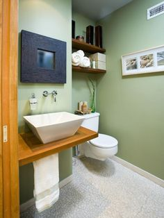 Spa-Like Atmosphere ~The sage-green walls instantly deliver a #Zen-inspired atmosphere in this small #bathroom.
