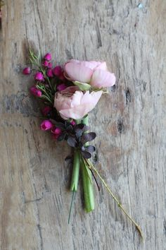 The corsages will be small, simple pinned-on corsages of seasonal greenery and foliages with blush ranunculus wrapped in ivory ribbon with the stems showing.