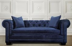 The uniquely beautiful Norwalk navy velvet sofa adds comfort and plenty of style to any room. Entirely made by hand, this sofa features hand-applied nail heads,