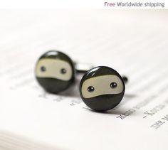 Ha! Super sneaky. Ninja cufflinks from BeautySpot on Etsy